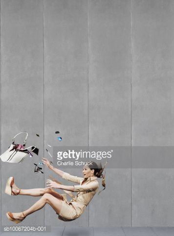 Stock Photo : Woman falling down on pavement