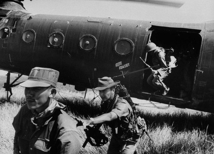 "Larry Burrows—Time  Life Pictures/Getty Images ""Vietnamese pile out of H-21 helicopter near Rach Gia. They flushed out 15 Viet Congs."""