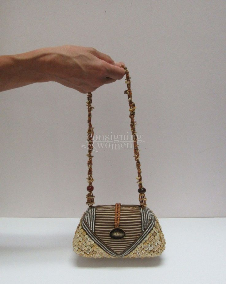 Mary Frances earth tone fabric, shell & bead embellished frame bag with magnetic closure.