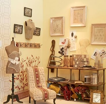 Spring 2015 display included drawings for lace designs, vintage buttons mounted as pictures, antique tassels and drapers' items such as giant bobbins with original thread.