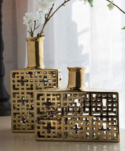NEW in - These luxe ornamental vases instantly add colour to any space. Cast from ceramic, this set of two of vases will be a fabulous addition to your living area or entertaining space.