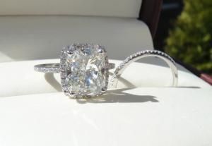 4.20 carat harry winston with 3.50 carat cushion cut center in a micropave setting, lol i wish!!!