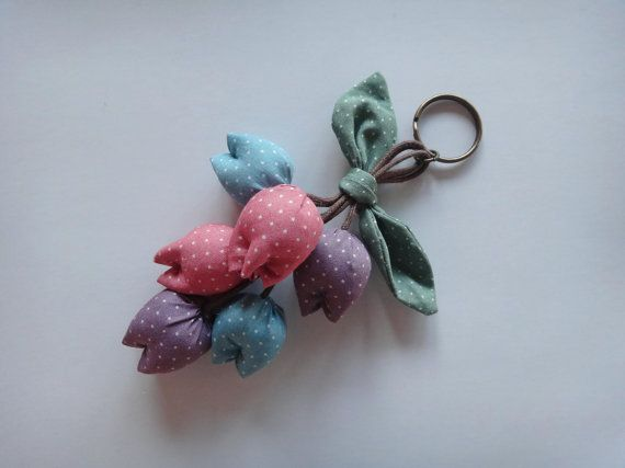 Adorable handmade tulip keychain in the shades of pink, purple and blue. It can be used as keychain or you can hang it on your bag/purse.    After payment is received, I will ship your item within 2-3 business days via Thailand's registered airmail (with tracking information) to ensure that your package will not be lost during delivery. Delivery normally takes 2-3 weeks depending on your location.    Thanks for visiting my shop!    Please take a moment to read my shop policies using the ...