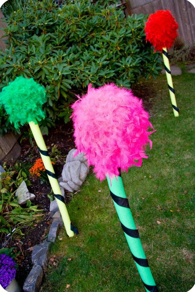 Lorax Birthday Party Ideas:  How to make GIANT Truffula Trees from swimming pool floaties.