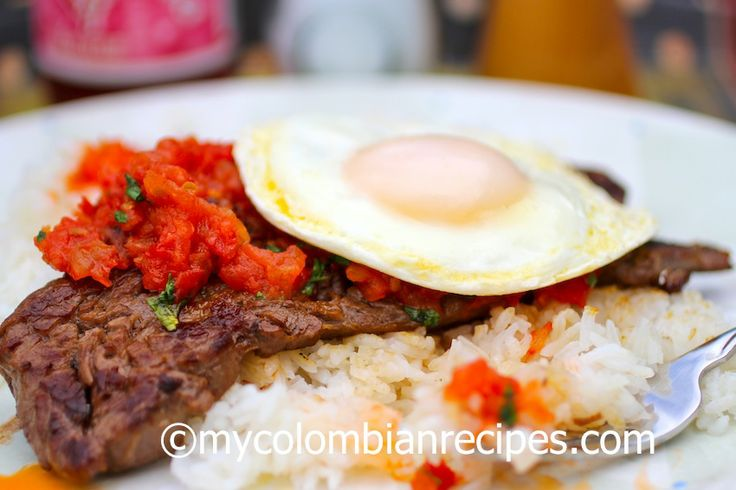 Bistec a Caballo is a traditional Colombian dish. It is basically a piece of steak with a tomato and onion sauce, topped with a fried egg