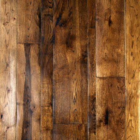 Traditional solid wood flooring, ancient oak, totally sanded by our artisans, finished with natural oils and waxes.