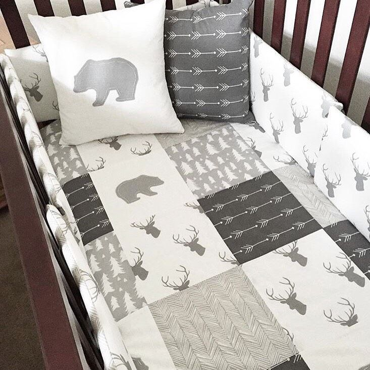 Woodland nursery bedding in gray and white with bears, arrows, and deer. Love for a boy woodland or mountain nursery.
