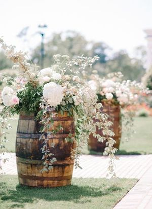 whiskey wine barrel aisle markers for country wedding ideas