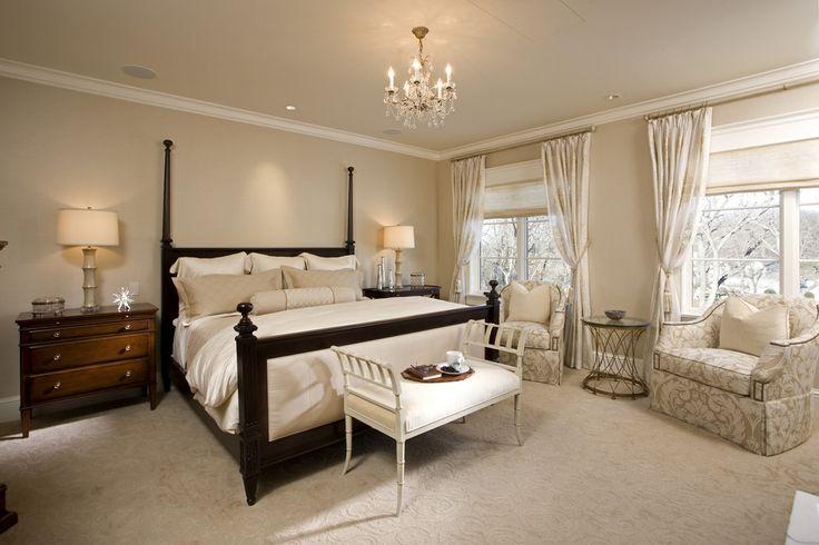 Spacious sunny bedroom with solid dark bedframe