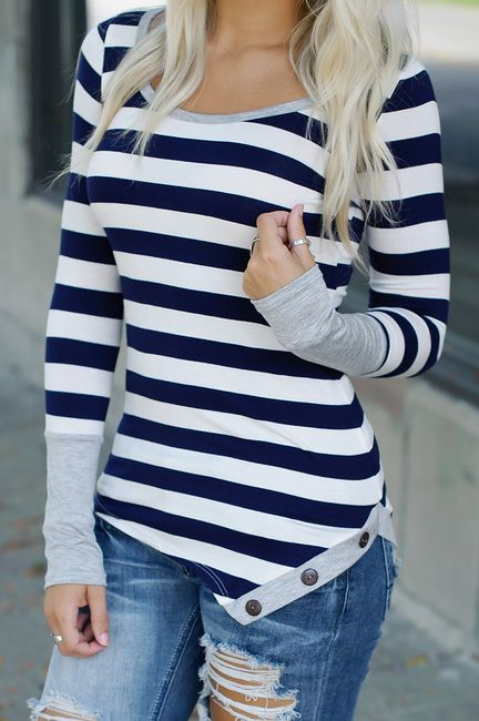 Navy striped top with grey colorblock sleeves and colorblock and button hem detail.