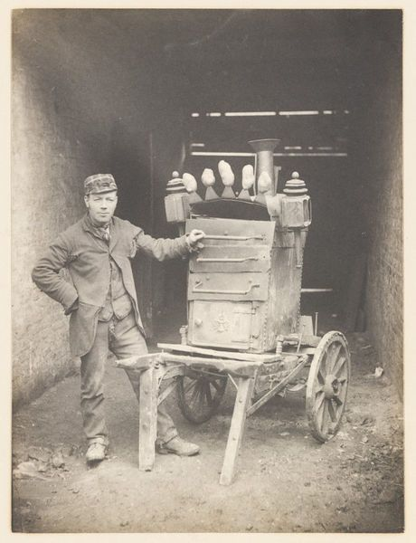 Man selling baked potatoes from the National Photographic Record and Survey by Edgar Scamell, London, 1892.