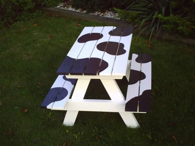 We were talking today about getting a cheap picNic table and painting it in a fun way.  Sophie suggested zebra stripes, but this is super fun too!