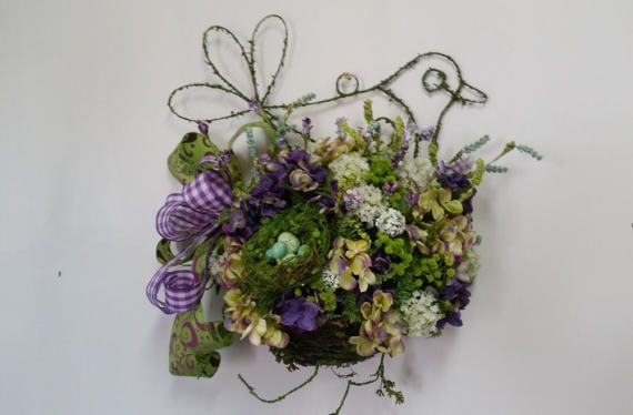 Spring bird door basket arrangement, Spring door arrangement, Hydrangea door arrangement, Spring wreath, Spring door hanger, Hydrangea wreath This unique vine and moss covered wire bird door basket is stunning! It is filled to the brim with green and purple hydrangea, mini white snowball flowers, green and purple wildflower stems, lush greenery, an adorable, egg filled nest, and a whimsical purple and green bow. You will simply love the way this looks on your front door, a real eye catcher…