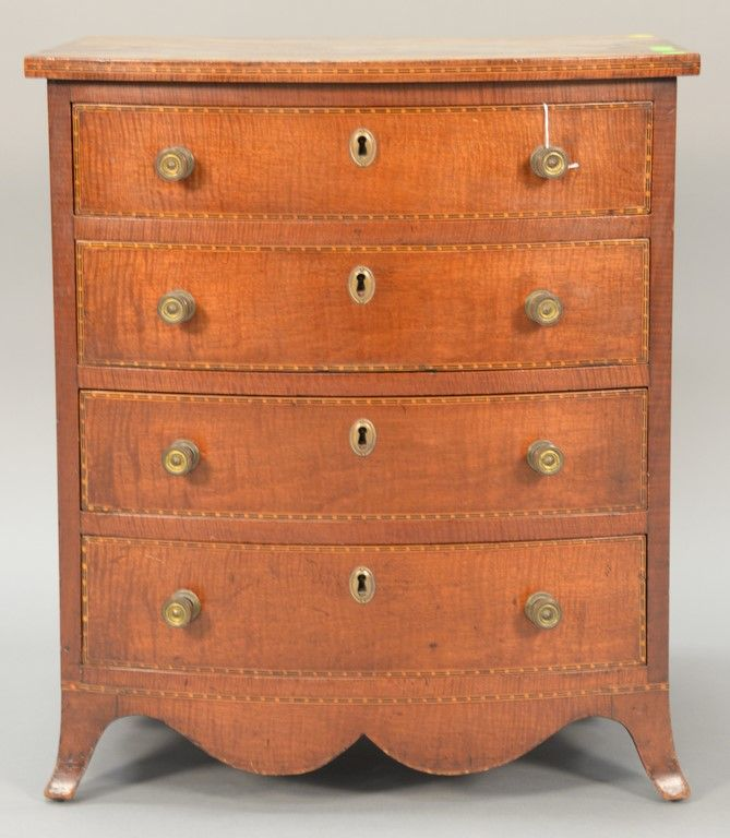 Margolis mahogany diminutive chest having four bowed front drawers of fiddleback mahogany, all set on French feet having two hand written Margolis labels.  ht. 24 in.; wd. 19 1/2 in.; dp. 17 1/2 in.  Provenance: Property from the Estate of Sylvia Leven of Bloomfield, Connecticut. Realized Price $5,100.00