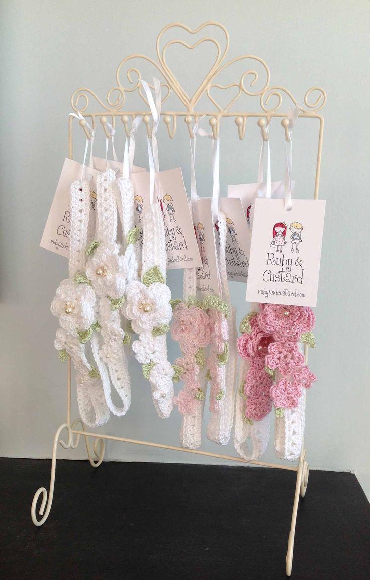 Crochet flower girl headbands on an upcycled jewellery stand - ready for a craft fair
