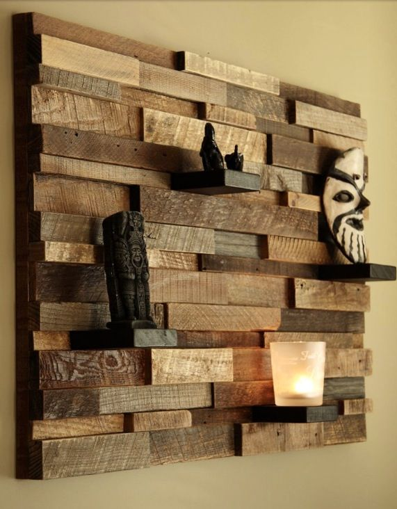 Salvaged wood/pallet wood, cut into various widths and lengths, collaged together for an abstract wall shelving piece. Lay multiple boards on their edges throughout the design to form the shelves.