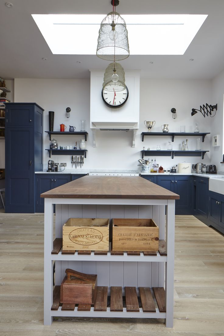 Charlie Kingham South-West London Edwardian House | A traditional kitchen with industrial highlights. A hardwood shaker style kitchen in located in south-west London. Mylands 'Bond Street' Blue hand painted finish, an island with breakfast bar (Mylands Crace), Integrated larder, walk-in pantry, Mercury range cooker and large shaker sink.