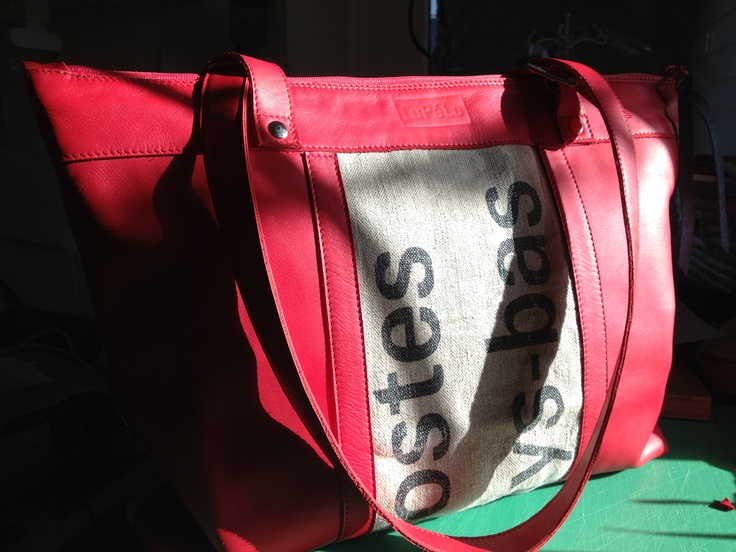 big shoulderbag, made of red leather and the used dutch postbag