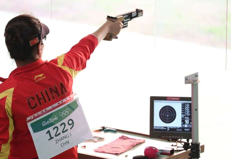 Jingjing Zhang of China prepares to shoot during the women's 25-meter pistol precision qualification shooting event in the Rio 2016 Rio Olympic Games at Olympic Shooting Centre.  -  August 9, 2016