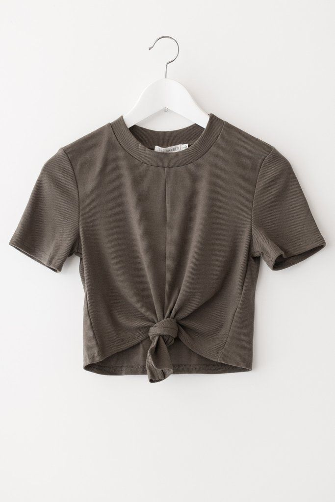 Mock neck crop top with front knot detail and short sleeves. Made with soft and lightweight ribbed knit material that has a good stretch. Available in Olive or Charcoal. 95% Polyester 5% Spandex Imported