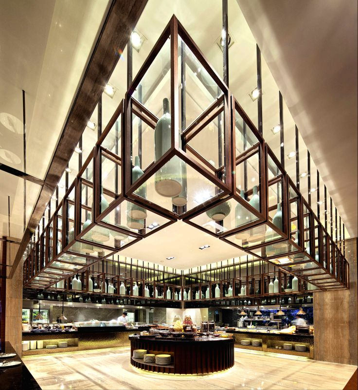 The gigantic wooden open grid above the buffet server takes the center stage of the restaurant︱Sheraton Huadu Resort, Guangzhou, China