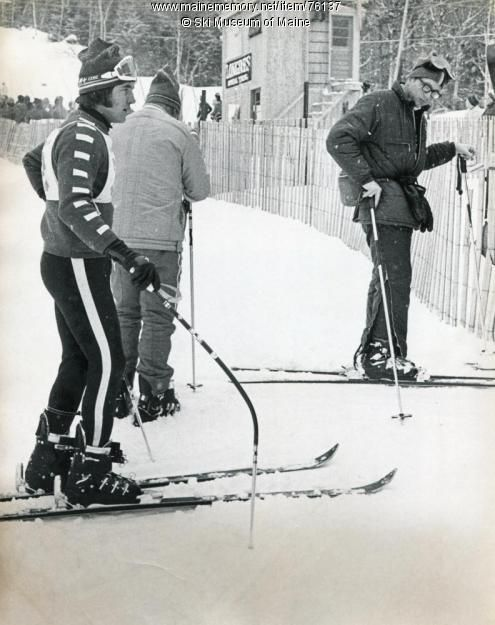 Finish mishap at the Sugarloaf Wold Cup, 1971. Swiss ski racer Manfred Jakober is seen in the finish area after crashing against the fence. He finished the race successfully but could not stop before hitting the wooden safety fence. The result was a bent pole and bruised ego. Item # 76137 on Maine Memory Network