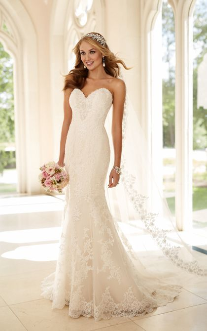This designer fit-and-flare strapless wedding dress from Stella York is made from gorgeous lace over satin and features hand-sewn Diamante embellishments throughout. Choose from a corset closure or an easy-close zipper under Stella crystal buttons.