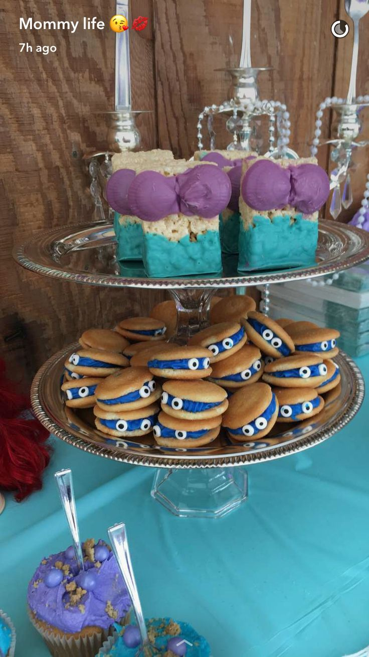 Little mermaid treats, Rice Krispies dipped in chocolate with chocolate sea shells and clams made with wafer cookies and frosting with little eyes.