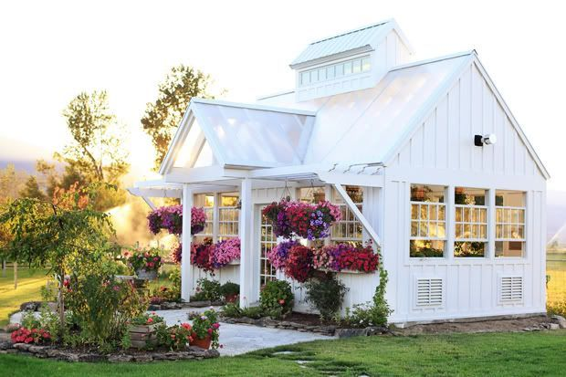 This is a beautiful greenhouse!  This woman lives on a bunch of dream land.  Old farm house fixed up, pond, greenhouse, fresh air, potager garden, everything.