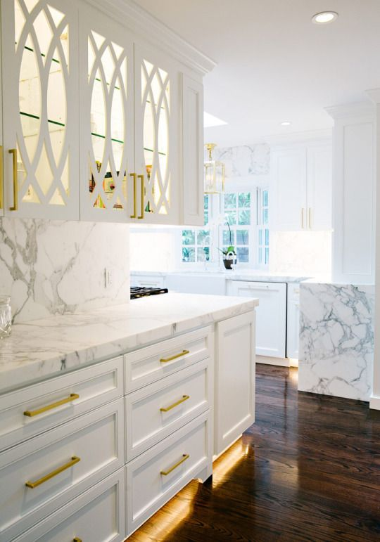 love the white custom cabinets + marble