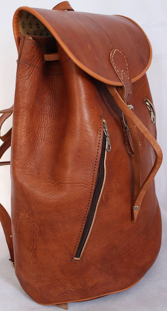 Vintage Style Real Genuine Quality Leather Bag Rucksack Backpack Boho Chic Strong rucksack which has many uses and is ideal for weekends away, Music Festivals School, etc Product Details Handmade and not massed produced Made with thick genuine quality Calf (Cow) leather Fully lined