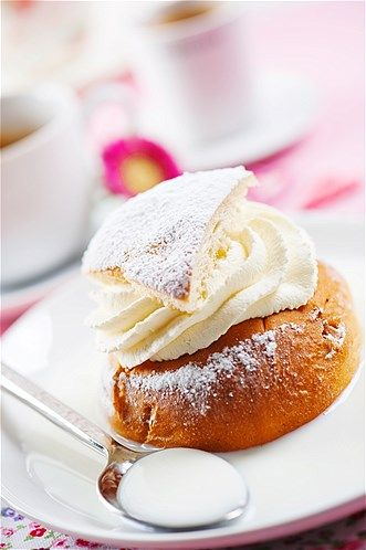 Semla is Scandinavia's answer to the cream puff. It's a spiced wheat bun that has been hollowed out and filled with a kind of almond ...