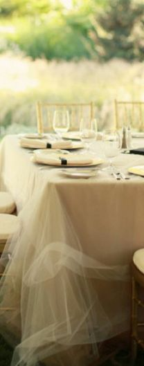 This would be easy to recreate.  Extra wide tulle over top a simple white or ivory tablecloth