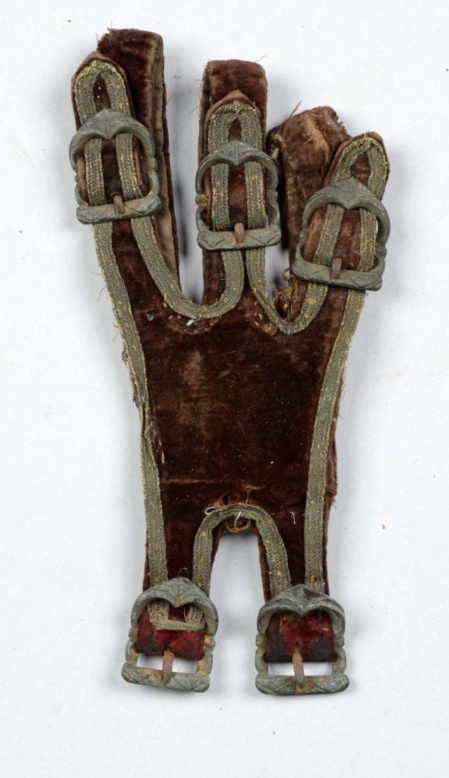 """The sword hanger of burgundy velvet with bullion edging. Five period small buckles. Leather backing. Probably made for a small sword. Showing wear and patina, with buckles corroded. Circa late 17th century. Condition (Good). Size 4"""" x 7-1/2"""""""
