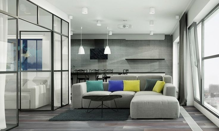 a lounge with a view of the kitchen