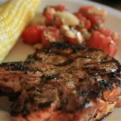 Lime juice, fresh basil, and fresh garlic are used as a simple marinade for these thick, grilled pork chops.