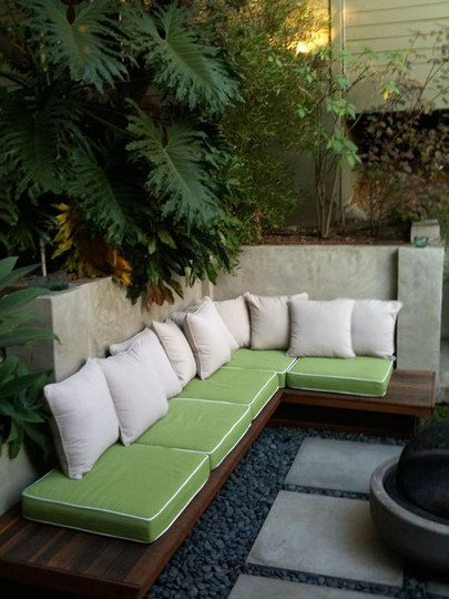 i like the wood bench against the rendered wall - for our patio corner. Juliana-backyard-01_rect540