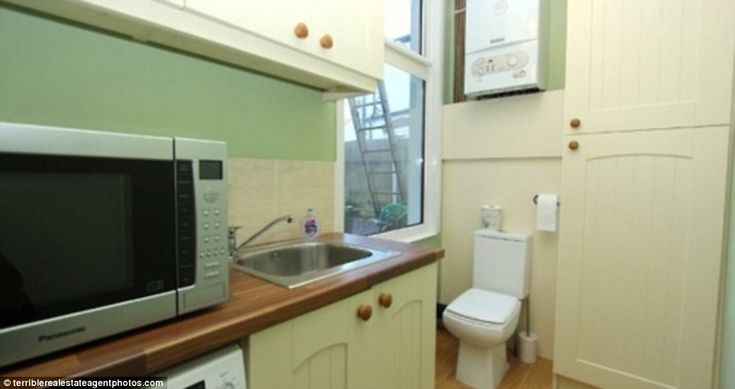 Not content with positioning a toilet in a kitchen, the owners of this property have placed it next to a large window