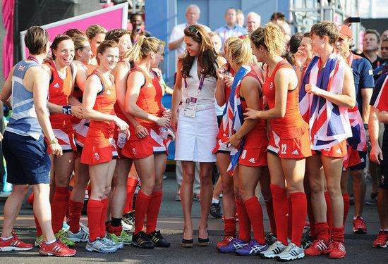 Catherine poses for a team pic with the Team GB field hockey team