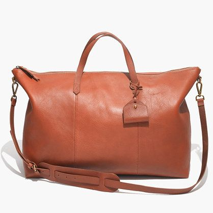 """You asked for it: We sized up our signature ruggedly cool, worn-in leather carryall so it's perfect for a weekend away (or even just a crosstown trek). Low-key, in a style and material that lasts forever, this version comes complete with a handy removable shoulder strap, secure top zips and a cool little luggage tag. <ul><li>Leather.</li><li>Zip closure.</li><li>Interior zip pocket.</li><li>4 3/4"""" handle drop.</li><li>13 3/4""""H x 18 7/8""""W at bottom, 24 1/2""""W at top.</li><li>Import.</li></ul>"""