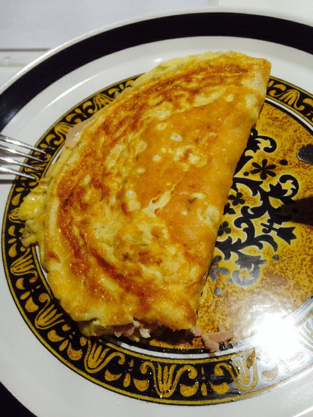 Ham and cheese omelette with ground cumin, coriander seeds, dried thyme and a pinch of cinnamon.