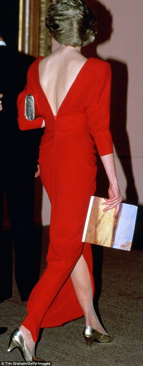 The princess wore this cherry red Victor Edelstein dress with a plunging V back (pictured)...
