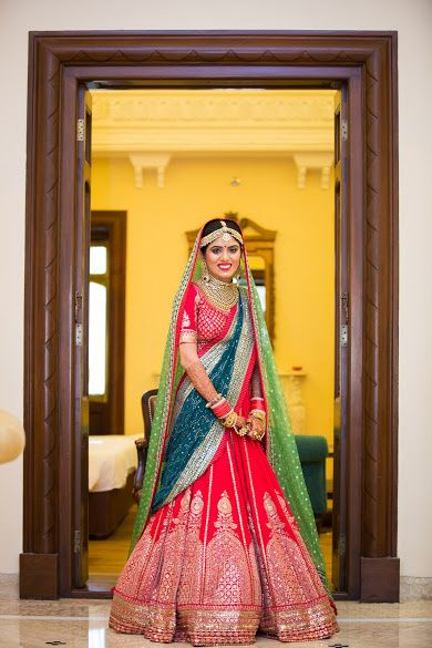 Bridal Lehengas - Red Bridal Lehenga with SIlver Work | WedMeGood | Red Leheng with SIlver Kalli Embroidery and Double Dupatta, Green and Teal, Gold Necklace and Earrings #wedmegood #indianwedding #indianbride #lehenga #bridal #teal #red #green