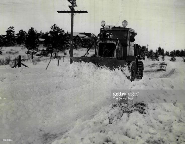 1938; Snowplow Clears Mountain Road; Snowplow Crews AT Bergen Park, Colo., Cleaned up their Job Today ,Nov.7, of opening Colorado Mountain Highways after the First Major Snowstorm of the Season. This Plow is at work on a Highway in The Denver Mountain parks about 20 Miles West of Denver.;