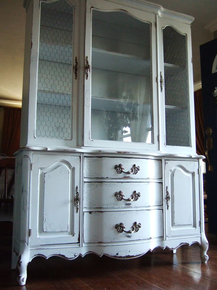 lightly distressed french country hutch in a french greyblue with walnut wood top and antiqued chicken wire
