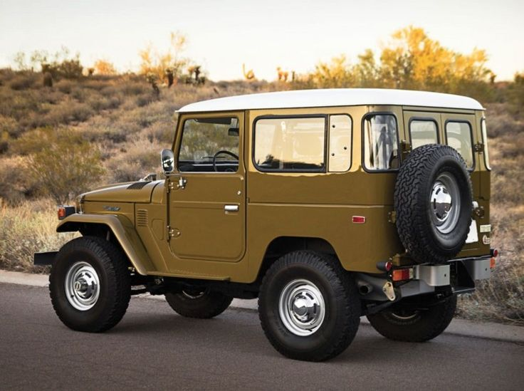 My first boyfriend's car!  (Maybe not exact, but close!). This one is a 1977 Toyota FJ40 Land Cruiser   Silodrome