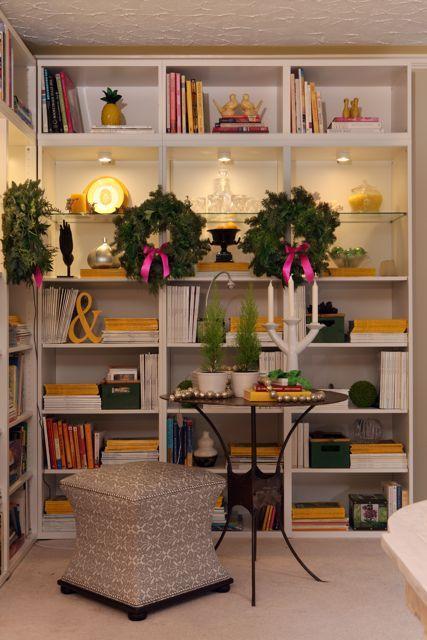 Like the idea of Christmas wreaths on bookshelves      via Colour Me Happy