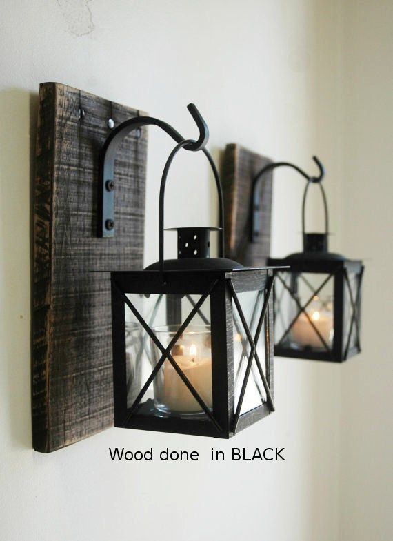 "This listing is for one set of two (2) rustic wooden wall-mounted sconces with metal hook and lantern. Candles are NOT included. The wooden sconce is made from 100% reclaimed wood.Item details:  Finished measurements of sconce are approximately 8"" tall x 5"" wideLantern measures 4""x4""x7"" tall from top of handle to bottom of lanternA saw tooth picture hanger is attached to the back for easy hangingSconce is painted or stained in the color/finish of your choice. Choose from the natural fin..."
