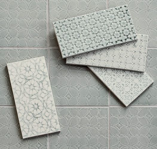 The Scraffito series was created by Michael Pratt employing an ancient technique of creating a sketch like pattern by scratching the surface of a tile to reveal a contrasting color. This etching process was used to explore tile influences from medieval Europe to Arabic geometry.