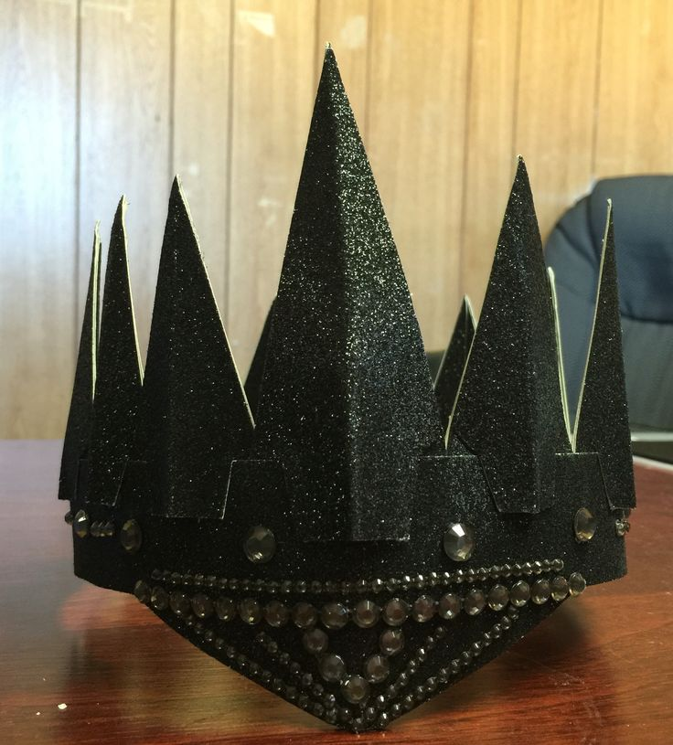 Evil Queen Crown  Supplies: hot glue gun, glitter paper (card stock paper), rhinestones.   Total cost of supplies: $8 (purchased at Michaels)